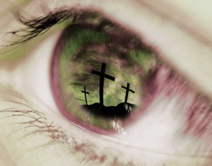 crosses reflected in an eye